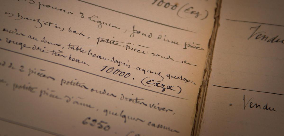 pages vieillies d'un livre de comptes ancien
