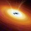Vue d'artiste de la coalescence de deux trous noirs supermassifs